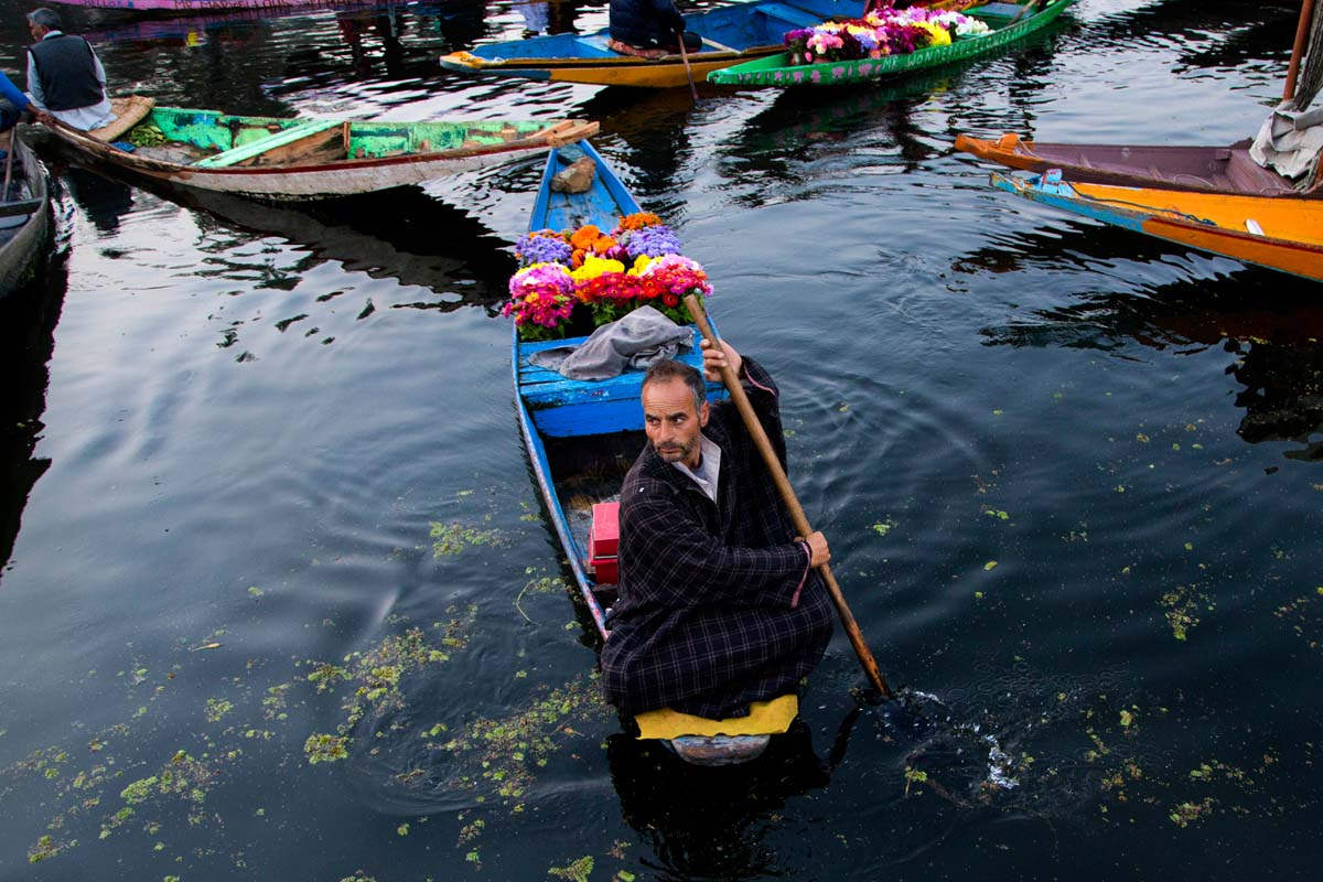 A Kashmiri flower vendor rows his boat at the floating vegetable market on Dal lake in Srinagar, Indian controlled Kashmir, Tuesday, Oct. 6, 2015. Vegetables traded in this floating market are supplied to Srinagar and many towns across the Kashmir valley. It's one of the major sources of income for the lake dwellers who spend years carefully nurturing their floating gardens from the weed and rich soil extracted from the lake bed. Sometimes a boat will weave through, selling flowers to the tourists who stay in the houseboats. (AP Photo/Dar Yasin)