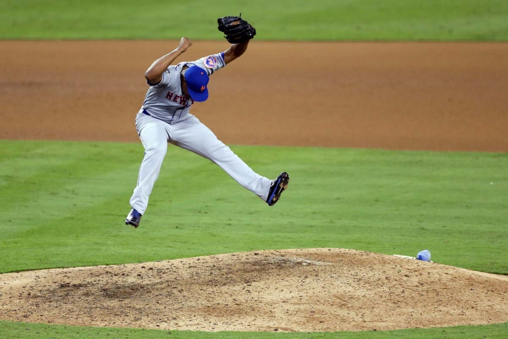 New York Mets relief pitcher Jeurys Familia celebrates a 3-2 win over the Los Angeles Dodgers in Game 5 of baseball's National League Division Series, Thursday, Oct. 15, 2015, in Los Angeles. (AP Photo/Gregory Bull)