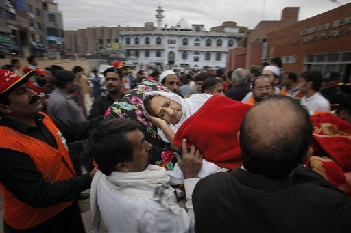 People rush an injured woman to a local hospital in Peshawar, Pakistan, Monday, Oct. 26, 2015. A powerful 7.7-magnitude earthquake in northern Afghanistan rocked cities across South Asia. Strong tremors were felt in Kabul, New Delhi and Islamabad on Monday. In the Pakistani capital, walls swayed back and forth and people poured out of office buildings in a panic, reciting verses from the Quran. (AP Photo/Mohammad Sajjad)