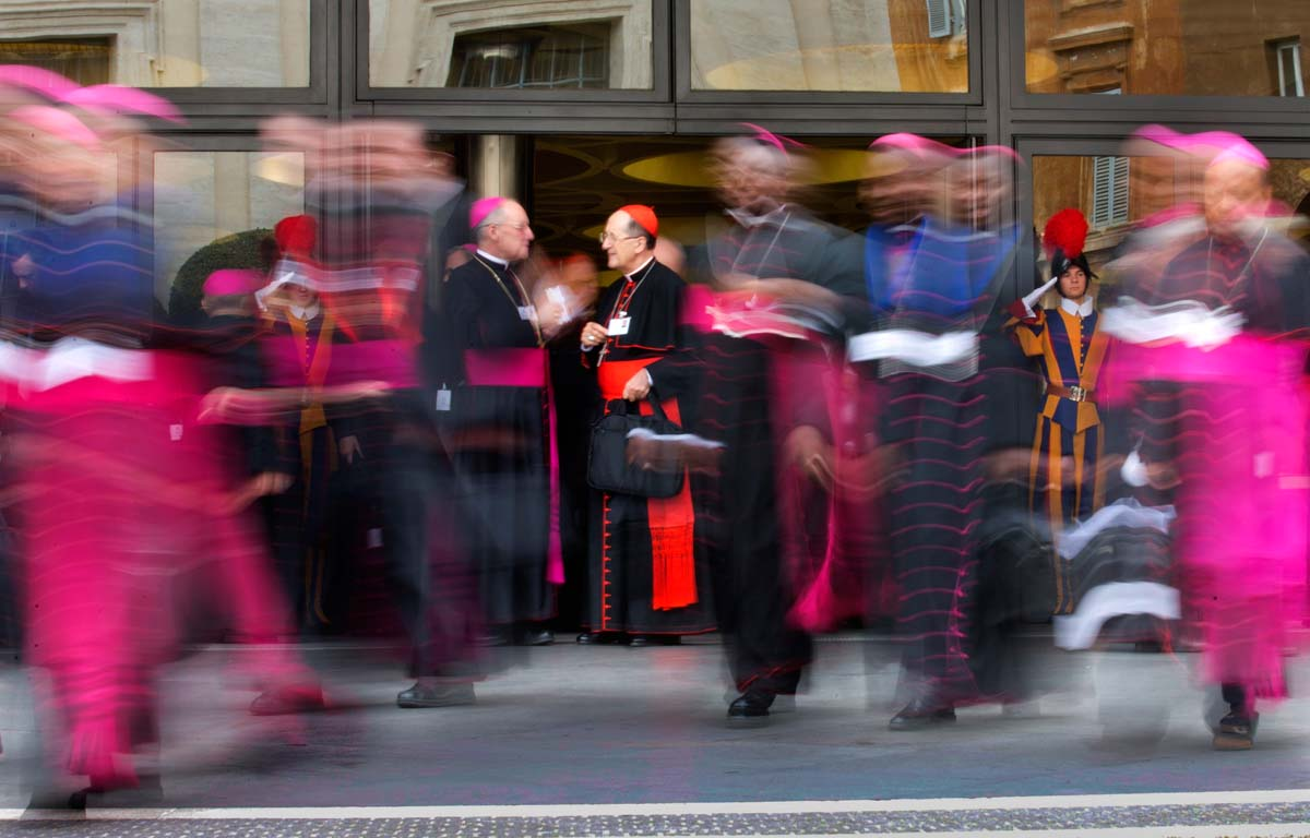 Cardinals and bishops leave at the end of a morning session of the Synod of bishops, at the Vatican, Friday, Oct. 9, 2015. (AP Photo/Alessandra Tarantino)