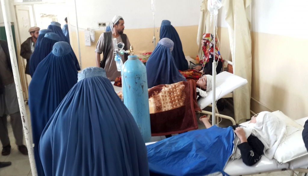 Afghan school girls are  treated at a hospital after an earthquake in Takhar province, northeast of Kabul, Afghanistan, Monday, Oct. 26, 2015. In Afghanistan's Takhar province, west of Badakhshan, at least 12 students at a girls' school were killed in a stampede as they tried to get out of the shaking buildings, a local official says. Sonatullah Taimor, the spokesman for the Takhar provincial governor, says another 30 girls have been taken to the hospital in the provincial capital of Taluqan. (AP Photo/Zalmai Ashna)