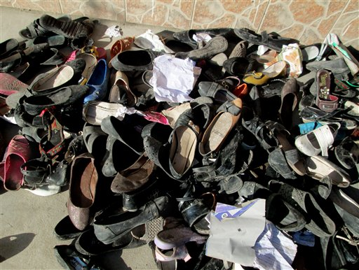 Shoes of Afghan school girls are seen on the ground after an earthquake hit in Takhar province, northeast of Kabul, Afghanistan, Monday, Oct. 26, 2015. In Afghanistan's Takhar province, west of Badakhshan, at least 12 students at a girls' school were killed in a stampede as they tried to get out of the shaking buildings, a local official says. Sonatullah Taimor, the spokesman for the Takhar provincial governor, says another 30 girls have been taken to the hospital in the provincial capital of Taluqan. (AP Photo/Naim Rahimi)