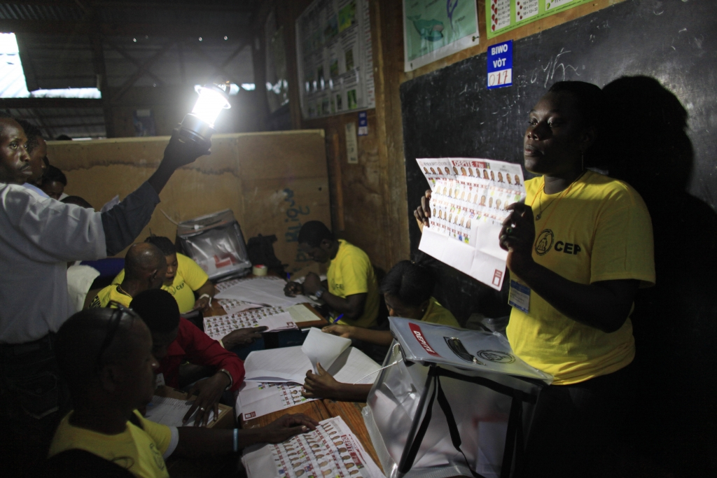 Electoral workers count ballots at a polling station in Port-au-Prince, Haiti, Sunday, Oct. 25, 2015. The country is holding the first-round presidential vote Sunday along with balloting for numerous legislative races and local offices. (AP Photo/Ricardo Arduengo)