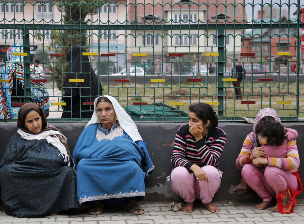 Kashmiri women sit on a footpath after they rushed out of buildings following tremors in Srinagar, Indian controlled Kashmir, Monday, Oct. 26, 2015. A strong earthquake in northern Afghanistan was felt across much of South Asia on Monday, shaking buildings from Kabul to Delhi and cutting power and communications in some areas. (AP Photo/Mukhtar Khan)