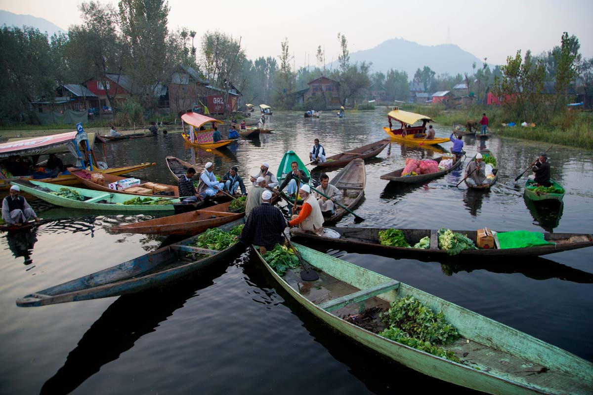 Kashmiri men take a break to chat while selling their produce at the floating vegetable market on Dal Lake in Srinagar, Indian controlled Kashmir, Tuesday, Oct. 6, 2015. Vegetables traded in this floating market are supplied to Srinagar and many towns across the Kashmir valley. It's one of the major sources of income for the lake dwellers who spend years carefully nurturing their floating gardens from the weed and rich soil extracted from the lake bed. (AP Photo/Dar Yasin)