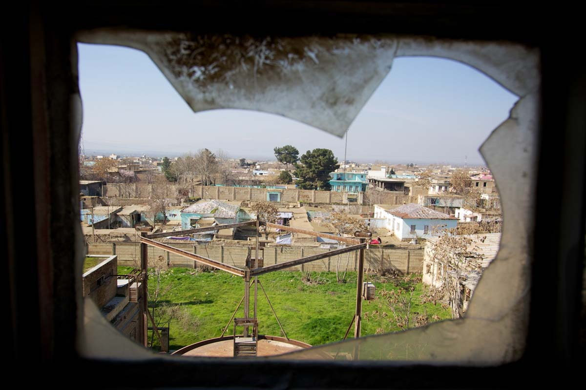 Kunduz as seen through the window of the cottons seed oil refinery at the Spinzer Cotton Factory in Kunduz.