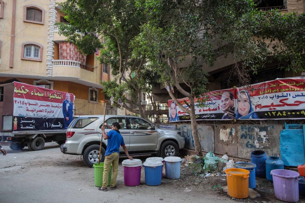 In this Thursday, Oct. 15, 2015 photo, campaign posters for Asmaa Ahmed Abdel Hakeem, an independent candidate for parliament, are seen near her campaign headquarters in Giza, Egypt, ahead of Egyptian parliamentary elections later this month. Hakeem is a manager of a family-owned school. It's her first time to running in an election and she says her family has been supportive. (AP Photo/Eman Helal)
