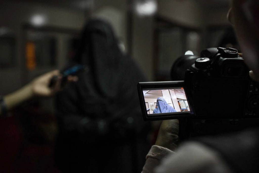 In this Sunday, Oct. 11, 2015 photo, Hanan Allam a candidate from the Al--Nour party, speaks with journalists after attending a women's campaign rally in Alexandria, Egypt, ahead of Egyptian parliamentary elections. As required by law for all party lists, the ultraconservative Salafi Al-Nour party has seven women on each of its two party lists of 15 candidates. Among the women is Allam, a 45-year-old pediatrician and head of the women's committee at Al-Nour party, which supported the military-led ouster of former President Mohammed Morsi and his now-banned Muslim Brotherhood. (AP Photo/Eman Helal)