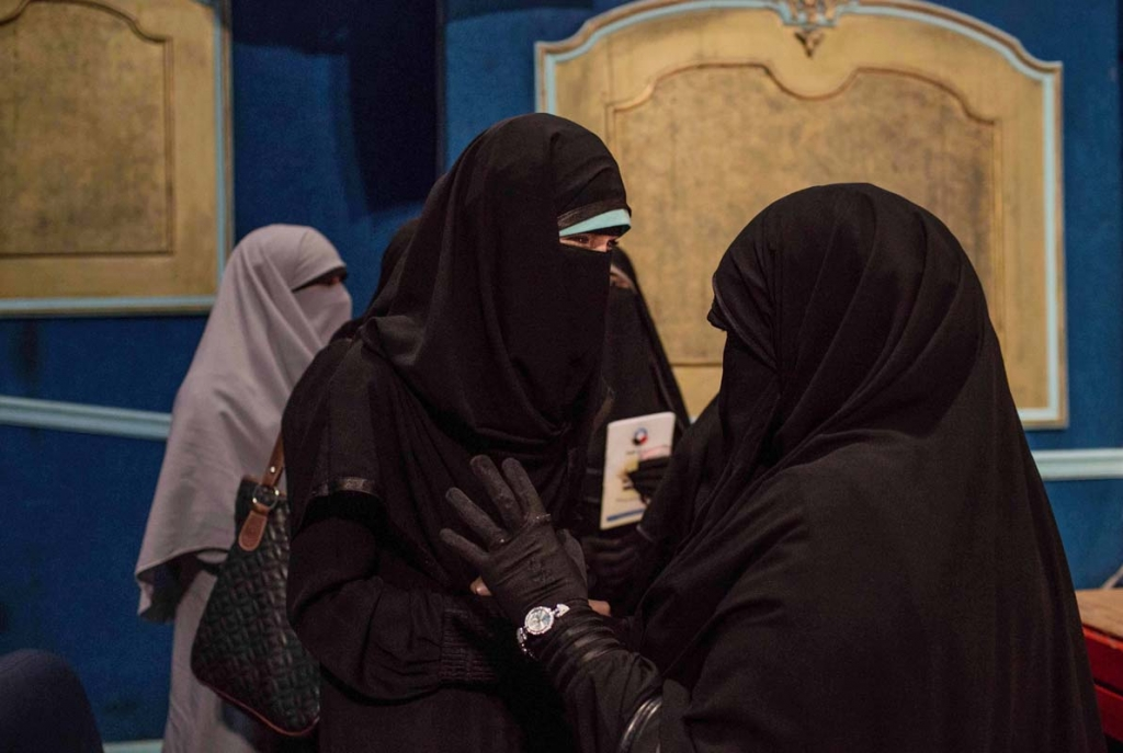 In this Sunday, Oct. 11, 2015 photo, Hanan Allam, a candidate from the Al--Nour party, right, speaks with a woman at a women's campaign rally in Alexandria, Egypt, ahead of Egyptian parliamentary elections. As required by law for all party lists, the ultraconservative Salafi Al-Nour party has seven women on each of its two party lists of 15 candidates. Among the women is Allam, a 45-year-old pediatrician and head of the women's committee of Al-Nour, which supported the military-led ouster of former President Mohammed Morsi and his now-banned Muslim Brotherhood. (AP Photo/Eman Helal)