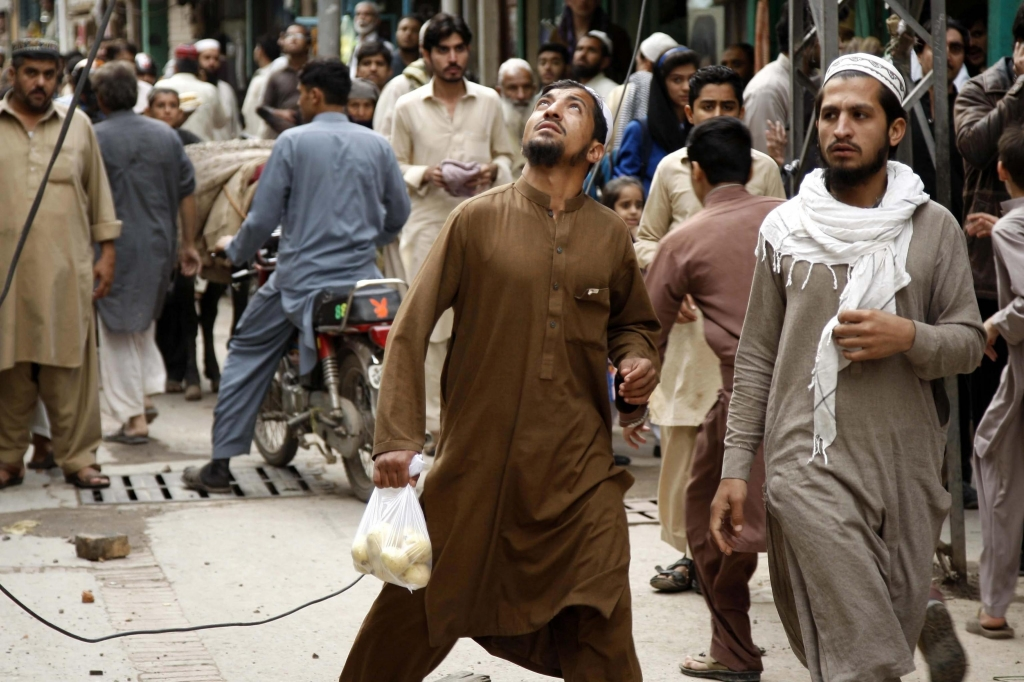 epa04996923 People react following a 7.7 magnitude earthquake, in Peshawar, Pakistan, 26 October 2015.  A strong earthquake with a magnitude of 7.7 hit northern Afghanistan's Hindu Kush mountain range causing damage in Pakistan and India as well. At least 69 people were killed in Pakistan, 20 in Afghanistan and hundreds wounded.  Tremors were felt in northern India including the capital New Delhi, causing thousands of people to evacuate buildings. Authorities also closed the underground train system.  EPA/ARSHAD ARBAB