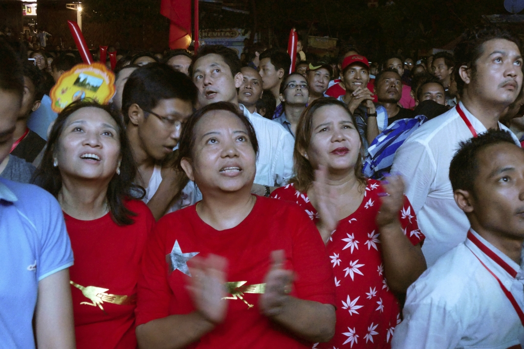 Supporters of Myanmar opposition leader Aung San Suu Kyi's National League for Democracy party watch the result of general election on an LED screen outside the party's headquarters Sunday, Nov. 8, 2015, in Yangon, Myanmar. Myanmar voted Sunday in historic elections that will test whether popular mandate can loosen the military's longstanding grip on power, even if opposition leader Aung San Suu Kyi's party secures a widely-expected victory. (AP Photo/Khin Maung Win)