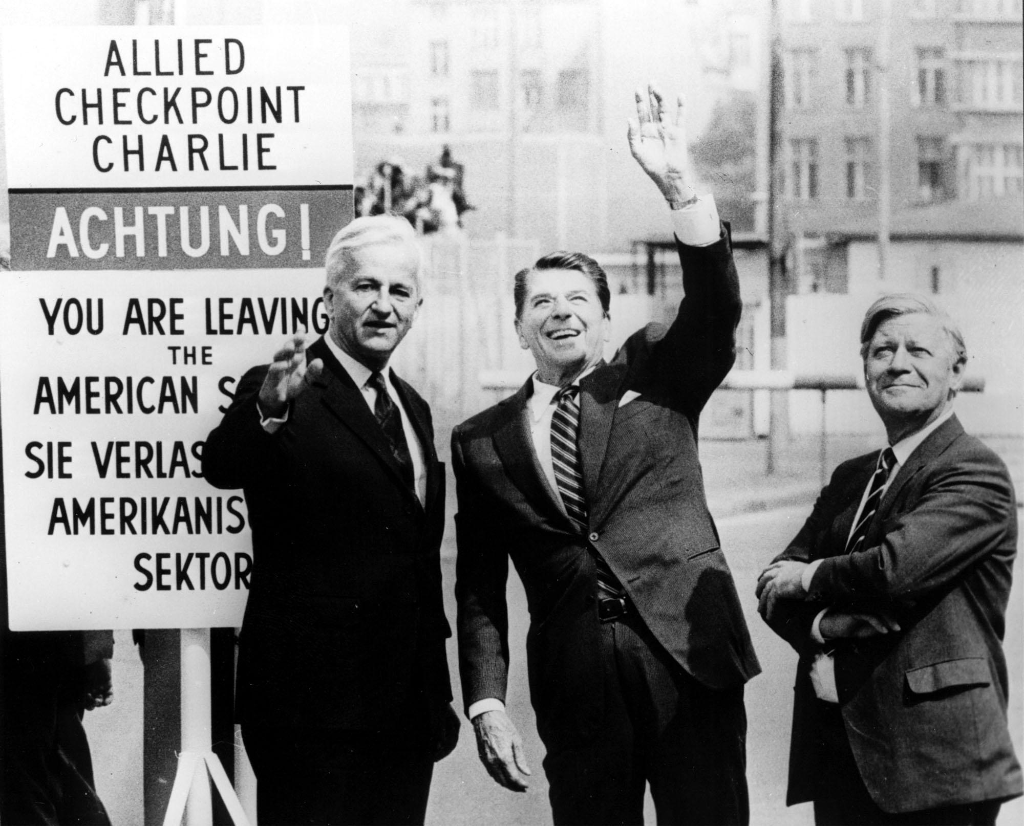 FILE - In this   June 11, 1982 file picture then  U.S. President Ronald Reagan, center,  waves to the crowd as he stands with then Mayor of West Berlin, Richard von Weizsaecker, left, and then West German Chancellor Helmut Schmidt in the American Sector at the Checkpoint Charlie in West Berlin.       (ANSA/AP Photo, str.file)  B/W ONLY