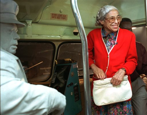 """Rosa Parks visits an exhibit illustrating her bus ride of December, 1955 at the National Civil Rights Museum in Memphis, Tenn., Saturday, July 15, 1995. Parks visited around the city to inaugurate her three-week """"Freedom Ride"""" throughout the country. (AP Photo/Troy Glasgow)"""