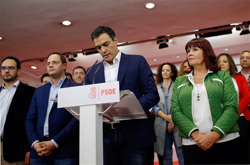 Pedro Sanchez, center, leader of the Spanish socialist party, PSOE, addresses journalists in Madrid following the national elections latest official results, Sunday, Dec. 20, 2015. A strong showing Sunday by a pair of upstart parties in Spain's general election upended the country's traditional two-party system, with results showing the ruling Popular Party won the most votes but fell far short of a parliamentary majority and risked being booted from power. (AP Photo/Francisco Seco)