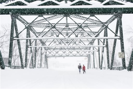 Snow covers the bridge over the Yellow Breaches Creek in New Cumberland, Pa., Saturday, Jan. 23, 2016. A massive winter storm buried much of the U.S. East Coast in a foot or more of snow by Saturday, shutting down transit in major cities, stranding drivers on snowbound highways, knocking out power to tens of thousands of people. (James Robinson/PennLive.com via AP) MANDATORY CREDIT; MAGS OUT