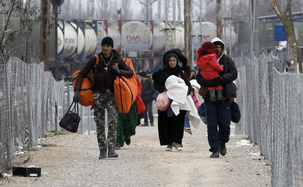 Refugees walk towards the border with Serbia, from the transit center for refugees near northern Macedonian village of Tabanovce, on Sunday, Jan. 24, 2016. Macedonia, Serbia and Croatia, the countries on the so-called Balkan migrant corridor that starts in Greece, are only letting in people whose stated final destination is Germany or Austria. (AP Photo/Boris Grdanoski)
