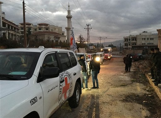 This picture provided by The International Committee of the Red Cross (ICRC), working alongside the Syrian Arab Red Crescent (SARC) and the United Nations (UN), shows a convoy containing food, medical items, blankets and other materials being delivered to the town of Madaya in Syria, Monday, Jan. 11, 2016. The town, about 15 miles (24 kilometers) northwest of Damascus, has been blockaded for months by government troops and the Lebanese militant group Hezbollah. Opposition activists and aid groups have reported several deaths from starvation in recent weeks. (ICRC via AP)