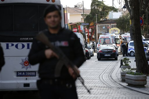 Policemen secure the historic Sultanahmet district, which is popular with tourists, as ambulances arrive after an explosion in Istanbul, Tuesday, Jan. 12, 2016. The Istanbul governor's office says the explosion at the city's historic Sultanahmet district has killed least 10 people. A statement says 15 other people were injured in blast. (AP Photo/Emrah Gurel)