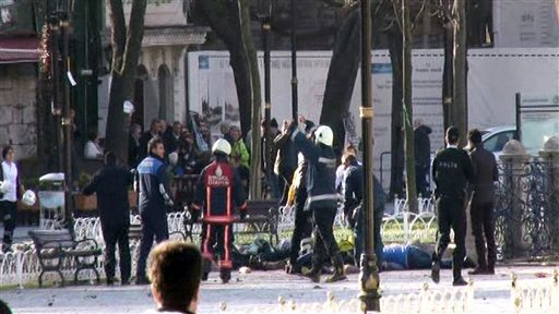 This image from video shows medics and security members with injured people lying on the ground after an explosion at Istanbul's historic Sultanahmet district, which is popular with tourists, Tuesday, Jan. 12, 2016. The cause of the explosion, which could be heard from several neighborhoods, was not immediately known but TRT said the blast was likely caused by a suicide bomber. (IHA via AP) TURKEY OUT