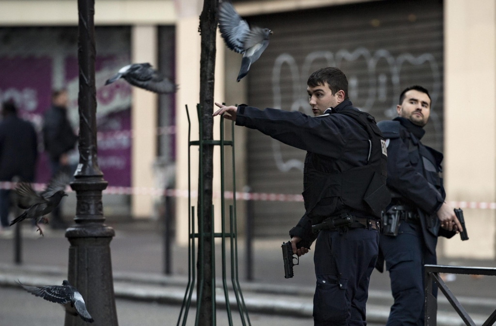 epa05091479 Police officers stand guard near a shooting scene after a man carrying a knife attempted to enter a Paris police station in the Goutte d'Or area, northern Paris, France, 07 January 2016. A man has been shot dead outside a Paris police station after apparently attacking the facility, amid fears that the incident might be an act of terrorism. Luc Poignant of the police union said the man allegedly shouted 'Allah is great' as he approached the facility. The incident comes on the one-year anniversary of an Islamist attack on the offices of satirical French newspaper Charlie Hebdo that prompted three days of terror and shootings in the city, ultimately resulting in 17 civilian deaths and the deaths of three Islamists as police closed in on them. EPA/IAN LANGSDON