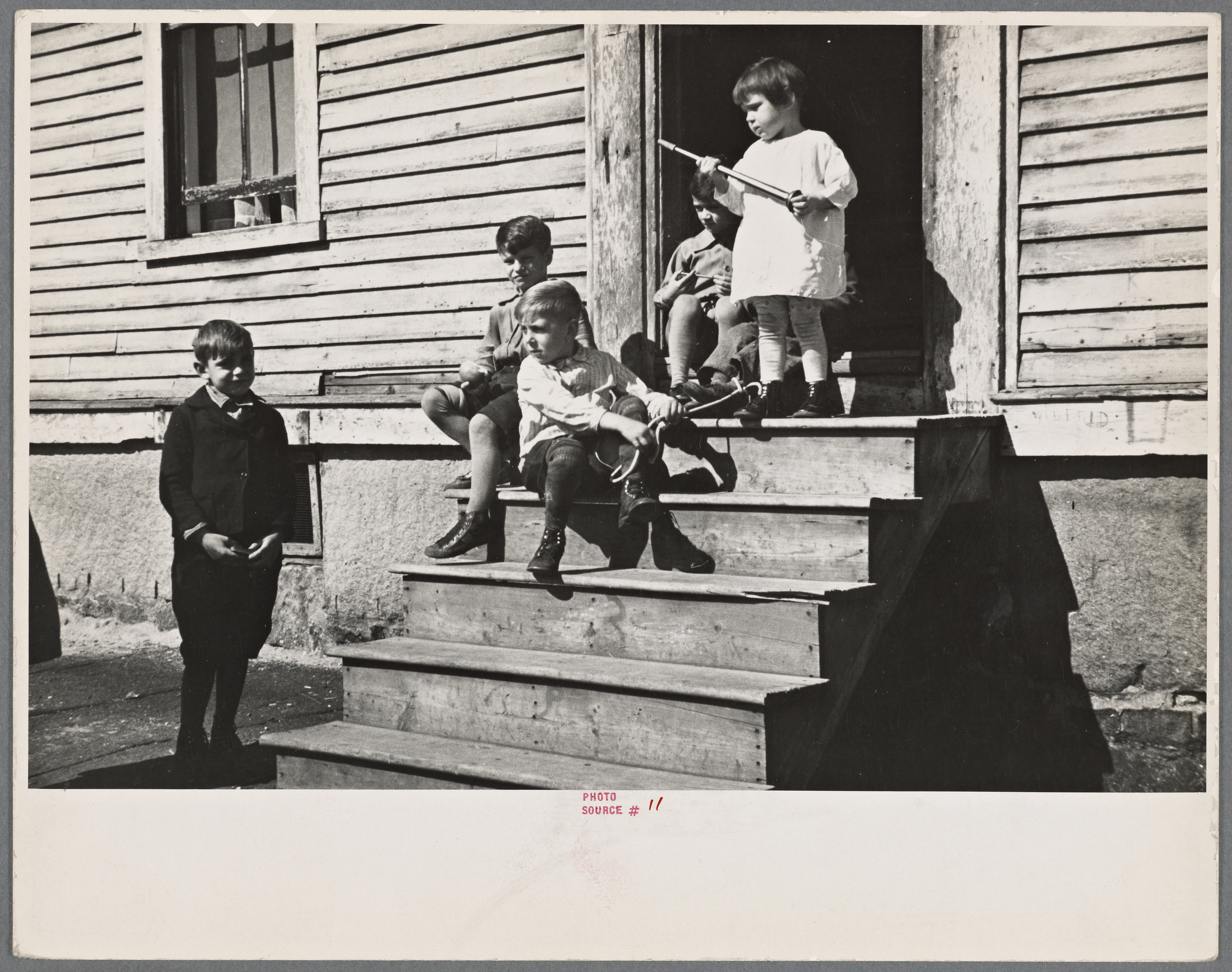 """The Miriam and Ira D. Wallach Division of Art, Prints and Photographs: Photography Collection, The New York Public Library. """"Children. Manchester, New Hampshire."""" The New York Public Library Digital Collections. 1936 Oct.."""