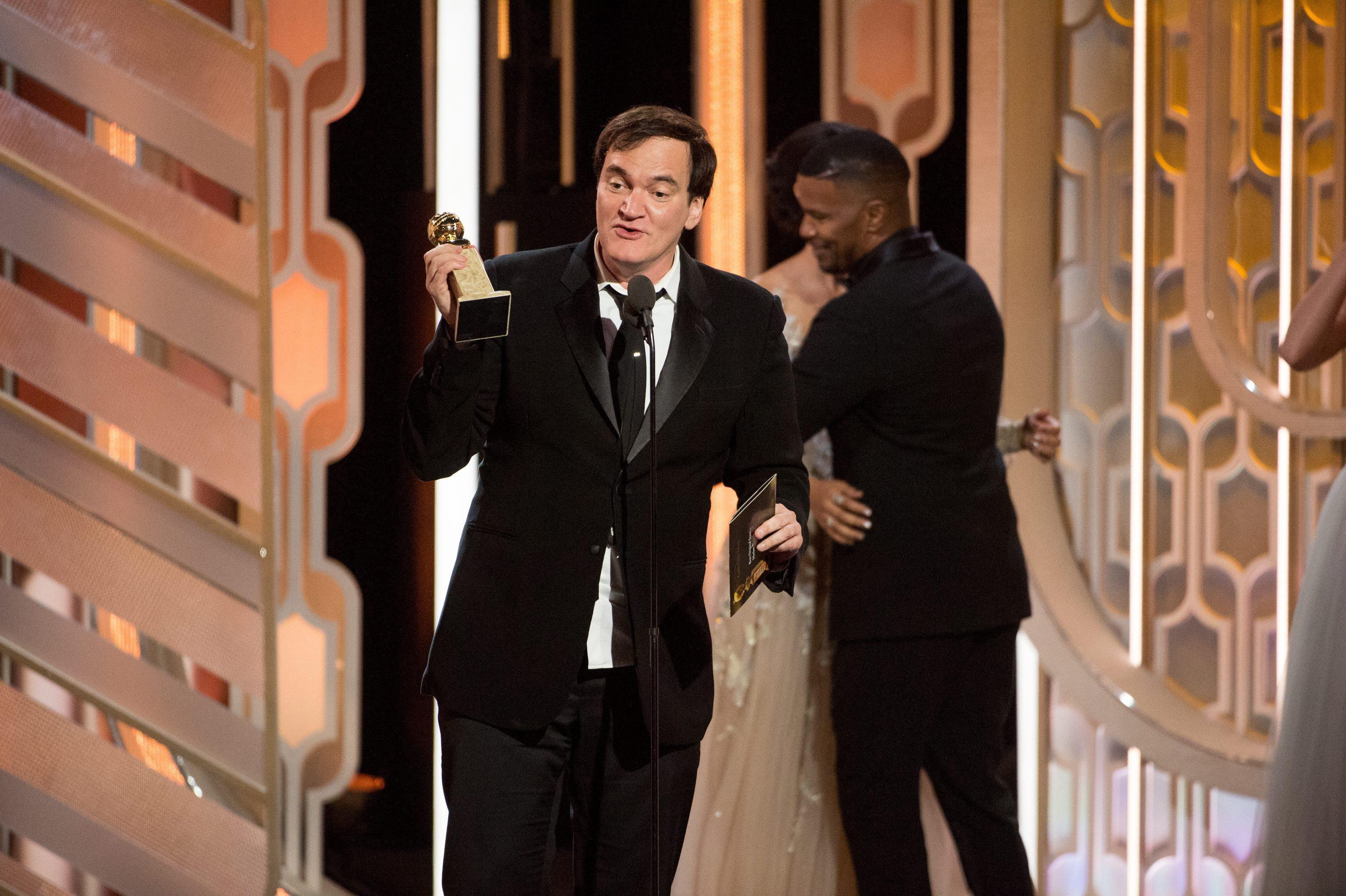epa05096674 A handout picture provided by the Hollywood Foreign Press Association (HFPA) on 10 January 2016 shows Quentin Tarantino accepting the Golden Globe for Ennio Morricone for Best Original Score in 'The Hateful Eight' at the 73rd Annual Golden Globe Awards at the Beverly Hilton in Beverly Hills in Beverly Hills, California, USA, 10 January 2016. EPA/HFPA HANDOUT EDITORIAL USE ONLY/NO SALES