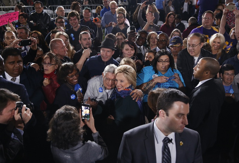Democratic presidential candidate Hillary Clinton, center right, poses for photos with supporters during a rally Friday, Feb. 19, 2016, in Las Vegas. (AP Photo/John Locher)