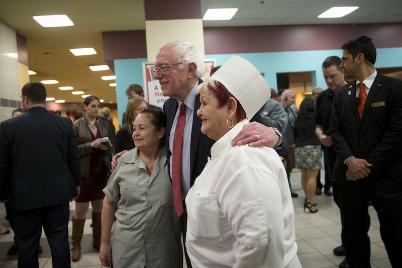 Democratic presidential candidate Sen. Bernie Sanders, I-Vt., center, poses with hotel workers at Caesars Palace hotel and casino Friday, Feb. 19, 2016, in Las Vegas. (AP Photo/Jae C. Hong)