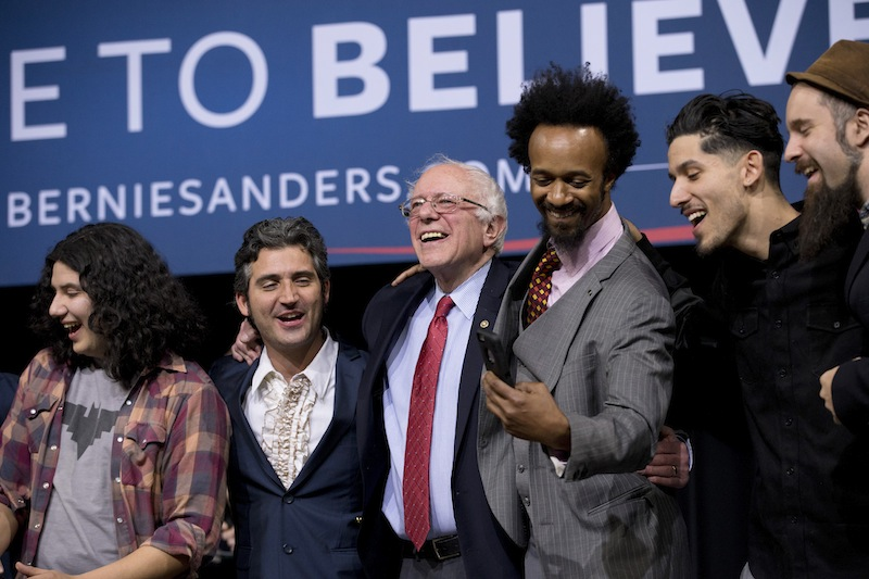 Democratic presidential candidate Sen. Bernie Sanders, I-Vt., center, sings with musicians and actors after a rally Friday, Feb. 19, 2016, in Henderson, Nev. (AP Photo/Jae C. Hong)