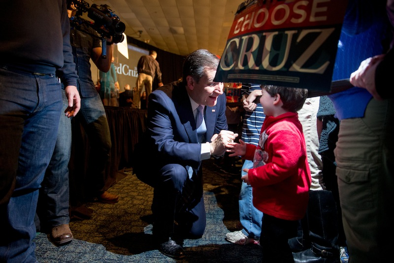 Republican presidential candidate, Sen. Ted Cruz, R-Texas, speaks to a boy in the audience after speaking at his South Carolina primary night rally at the South Carolina State Fairgrounds in Columbia, S.C., Saturday, Feb. 20, 2016. (AP Photo/Andrew Harnik)