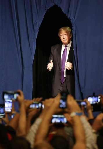 Republican presidential candidate Donald Trump arrives for a caucus night rally Tuesday, Feb. 23, 2016, in Las Vegas. (AP Photo/Jae C. Hong)