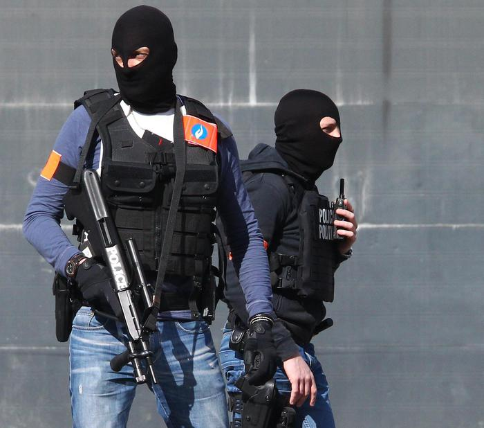 Belgian police officers patrol outside the Gare du Midi train station in Brussels, Tuesday, March 22, 2016. Explosions, at least one likely caused by a suicide bomber, rocked the Brussels airport and its subway system Tuesday, prompting a lockdown of the Belgian capital and heightened security across Europe. (ANSA/AP Photo/Michel Spingler)