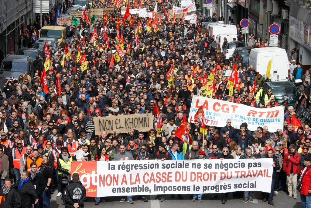 """Employes, workers and students demonstrate in Marseille, southern France, Wednesday, March, 9, 2016. France's transport unions and youth organizations hold strikes, amid anger over proposed labor law changes that take aim at the 35-hour workweek and make layoffs easier. Large banner being held at the front of the demonstration translates to """" No to the scrapping and diminishing of labour rights""""  .(AP Photo/Claude Paris)"""