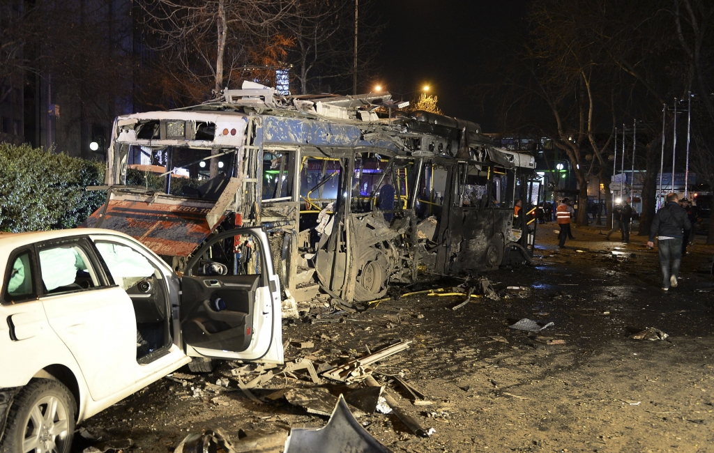 Damaged vehicles are seen at the scene of an explosion in Ankara, Turkey, Sunday, March 13, 2016. The explosion is believed to have been caused by a car bomb that went off close to bus stops. News reports say the large explosion in the capital has caused several casualties. (Selahattin Sonmez/Hurriyet Daily via AP) TURKEY OUT