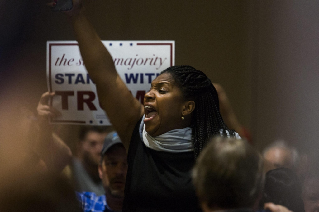 epa05211700 A protestor interrupts Republican presidential candidate Donald Trump as speaks at a town hall at the Tampa Convention Center in Tampa, Florida, USA, 14 March 2016. The winner-take-all Florida presidential primary is on 15 March 2016. EPA/JIM LO SCALZO