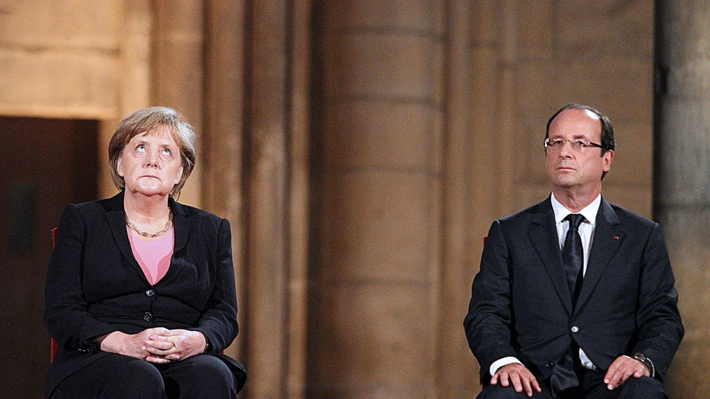 TOPSHOTS French President Francois Hollande (R) and German Chancellor Angela Merkel attend a ceremony in the Cathedral on July 8, 2012 in the northern French city of Reims, during a day of ceremonies to commemorate the 50th anniversary of renewed Franco-German relations after World War II. France and Germany have worked closely in recent years as they scramble to solve the eurozone's debt crisis and observers are watching with interest to see how the relationship develops between Hollande, a centre-left advocate of growth, and Merkel, a centre-right defender of austerity. AFP PHOTO / POOL / FRANCOIS NASCIMBENI TOPSHOTS-FRANCE-GERMANY-DIPLOMACY-HISTORY-EU