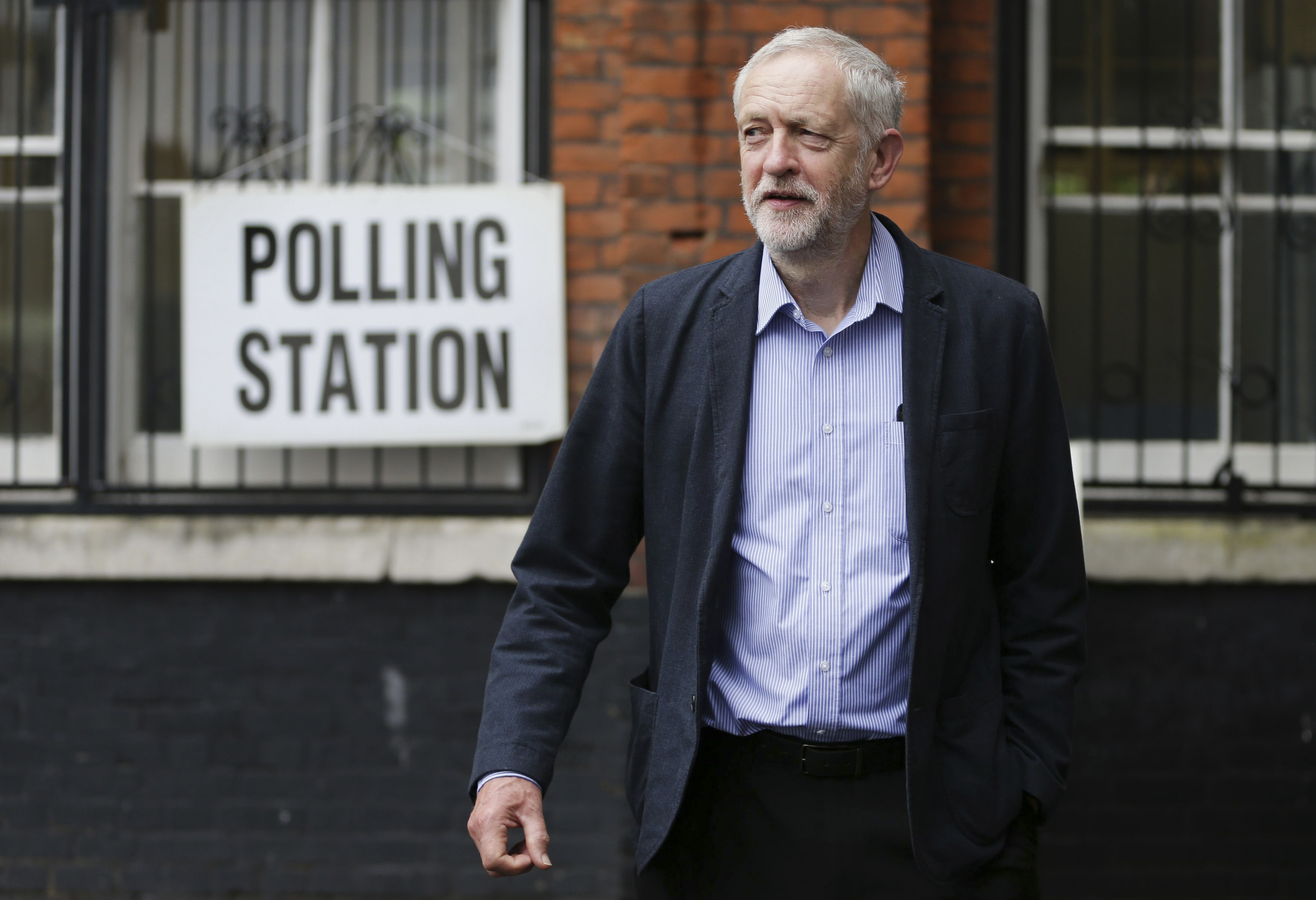 Britain's Labour Party leader Jeremy Corbyn smiles as he arrives to cast his vote in the EU referendum at a polling station in Islington, London Thursday June 23, 2016. Voters in Britain are deciding Thursday whether the country should remain in the European Union. (Daniel Leal-Olivas/PA via AP) UNITED KINGDOM OUT - NO SALES - NO ARCHIVE