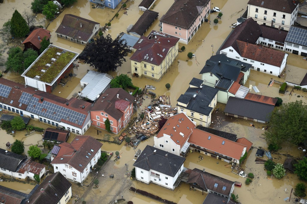 An aerial view shows the flooded streets and damages in Simbach am Inn, southern Germany, Thursday June 2, 2016.. Several people died when the small town was hit by heavy flooding the day before. ( Tobias Hase/dpa via AP)