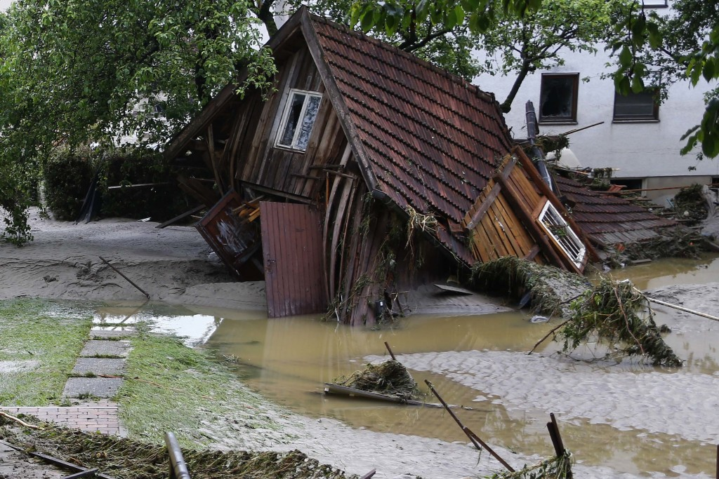 A wooden house damaged by floods in Simbach am Inn, Germany, Thursday, June 2, 2016. Several people have died in the flooding, which swept through the towns of Simbach am Inn and Triftern, while others have been reported missing. The waters have receded, and disaster relief crews were on the scene helping to clear the wreckage, while helping to prepare for more possible flooding. There are warnings of more storms in the forecast. (AP Photo/Matthias Schrader)