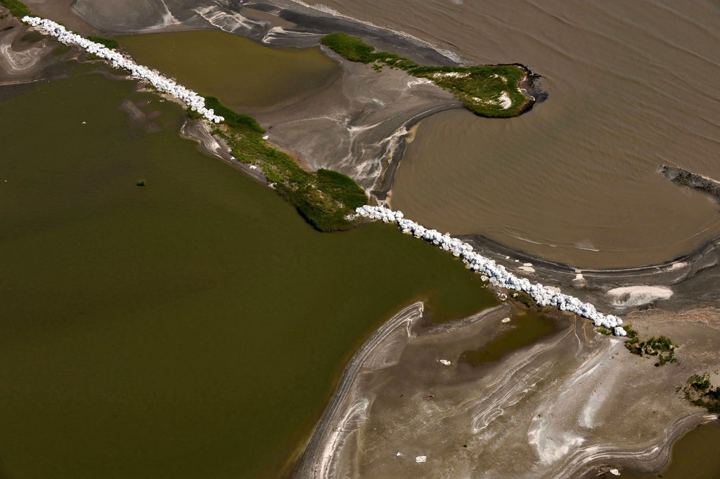 July 30, 2010 - Grand Isle, LA, United States of America - Aerial view of sandbag barriers to prevent crude oil leaking from the blowout of the BP Oil Deepwater Horizon from entering the marsh estuary July 30, 2010 in Grand Isle, Louisiana. (Credit Image: © Louisiana Governors Office/Planet Pix via ZUMA Wire)