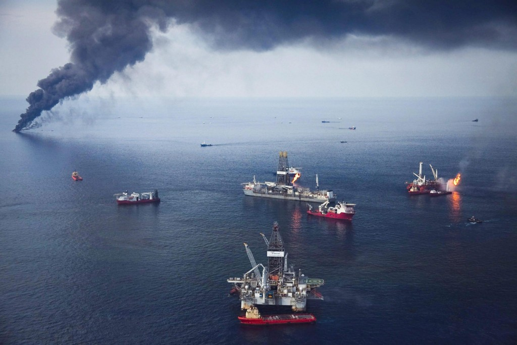 epa03471929 (FILE) A file photo dated 19 June 2010 showing oil from the BP Deepwater Horizon oil spill being corralled and burned on the surface of the Gulf of Mexico 50 miles off the coast of Louisiana, USA. British oil giant British Petroleum BP could face a fine of between three to five billion US Dollar in a settlement of criminal claims relating to the 2010 Deepwater Horizon oil spill in the Gulf of Mexico, media reports state on 15 November 2012. The fine could be the 'largest criminal penalty in US history', the reports add. The April 2010 Deepwater Horizon oil spill in the Gulf of Mexico had caused a severe environmental disaster in the region. EPA/BEVIL KNAPP