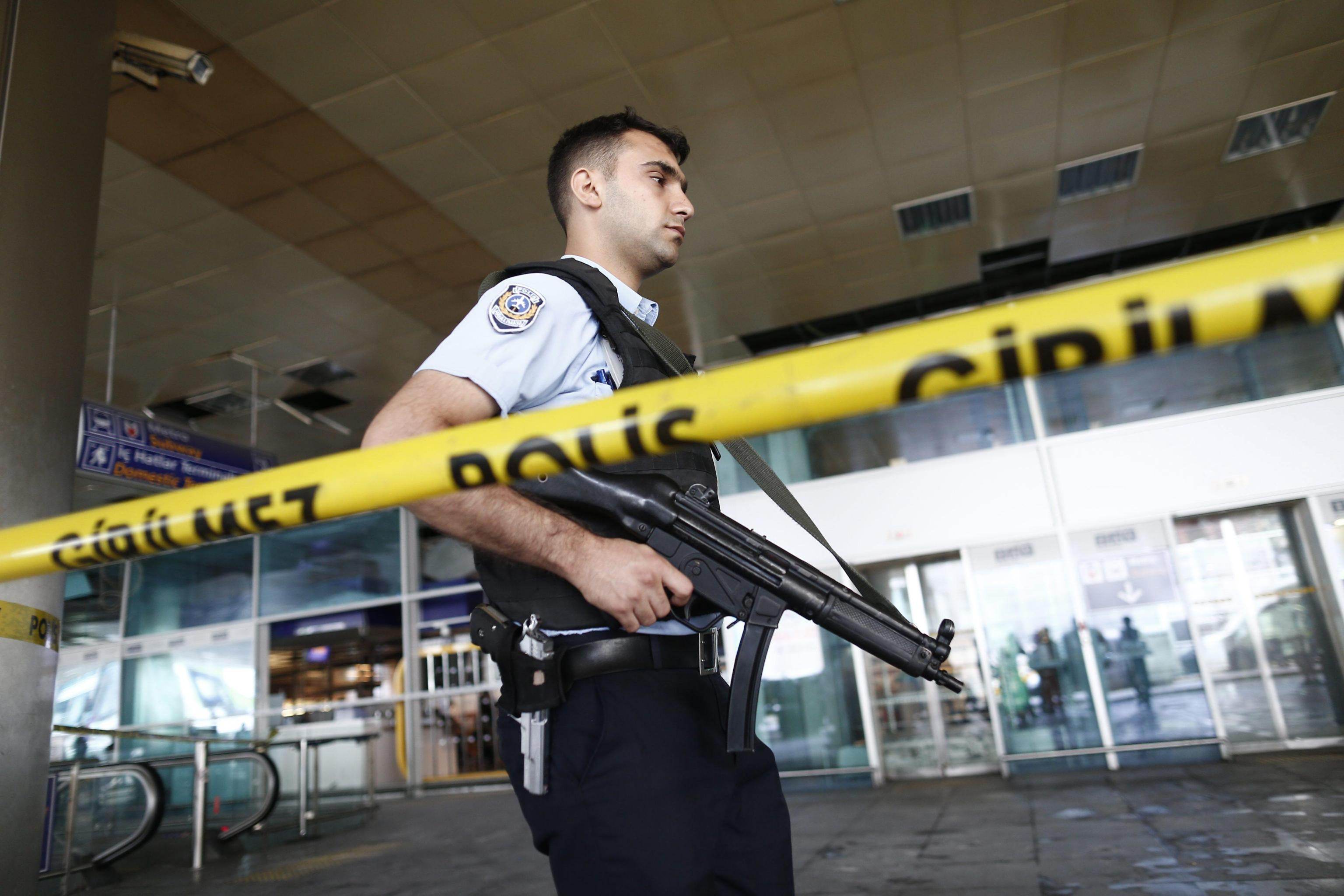 epa05397160 An armed Turkish policeman patrols behind a police line after multiple suicide bomb attacks at Ataturk international airport in Istanbul, Turkey, 29 June 2016. At least 36 people were killed and more than 140 others were wounded in three separate gun and bomb attack outside and inside the terminal of Istanbul's Ataturk international airport on 28 June, media reported quoting officials. The attacks have been linked to either the so-called Islamic State (IS or ISIS) militant group or Kurdish separatists, media added. EPA/SEDAT SUNA