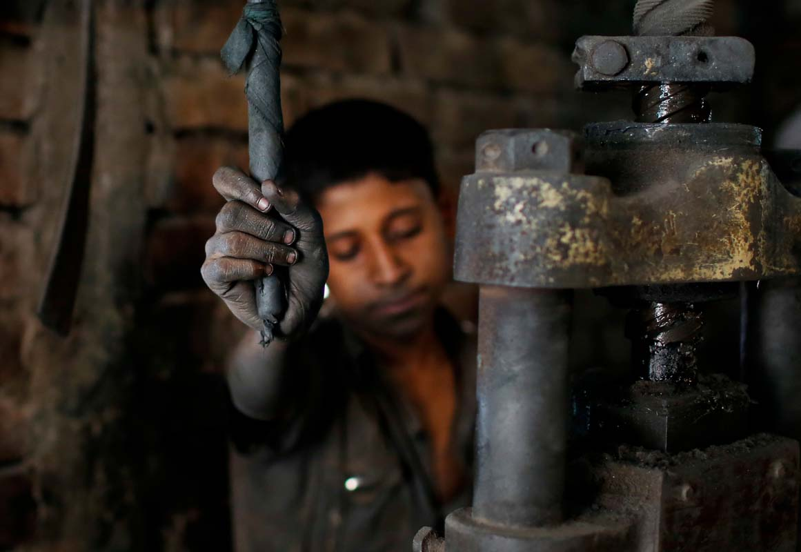 In this Sunday, June 12, 2016, photo, Abdullah, 12, works at a metal factory in Dhaka, Bangladesh. The World Day Against Child Labor, which was initiated in 2002 by the International Labor Organization to highlight the plight of child laborers, is observed across the world on June 12. (AP Photo/A.M. Ahad)