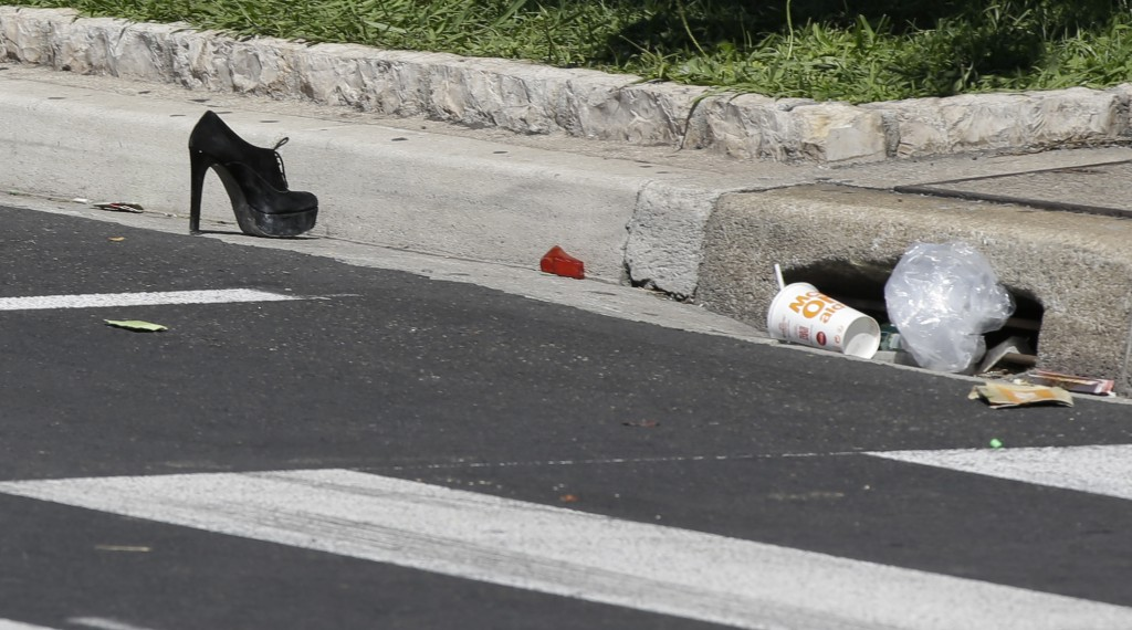 A shoe lays on the pavement at the scene of an attack after a truck plowed through a crowd in Nice, southern France, Friday, July 15, 2016. A large truck plowed through revelers gathered for Bastille Day fireworks in Nice, killing more than 80 people and sending others fleeing into the sea as it bore down for more than a mile along the Riviera city's famed waterfront promenade. (AP Photo/Luca Bruno)