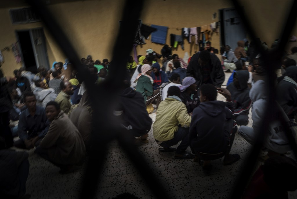 People* held in a detention centre in Tripoli, Lybia *Refugees, migrants and asylum seekers