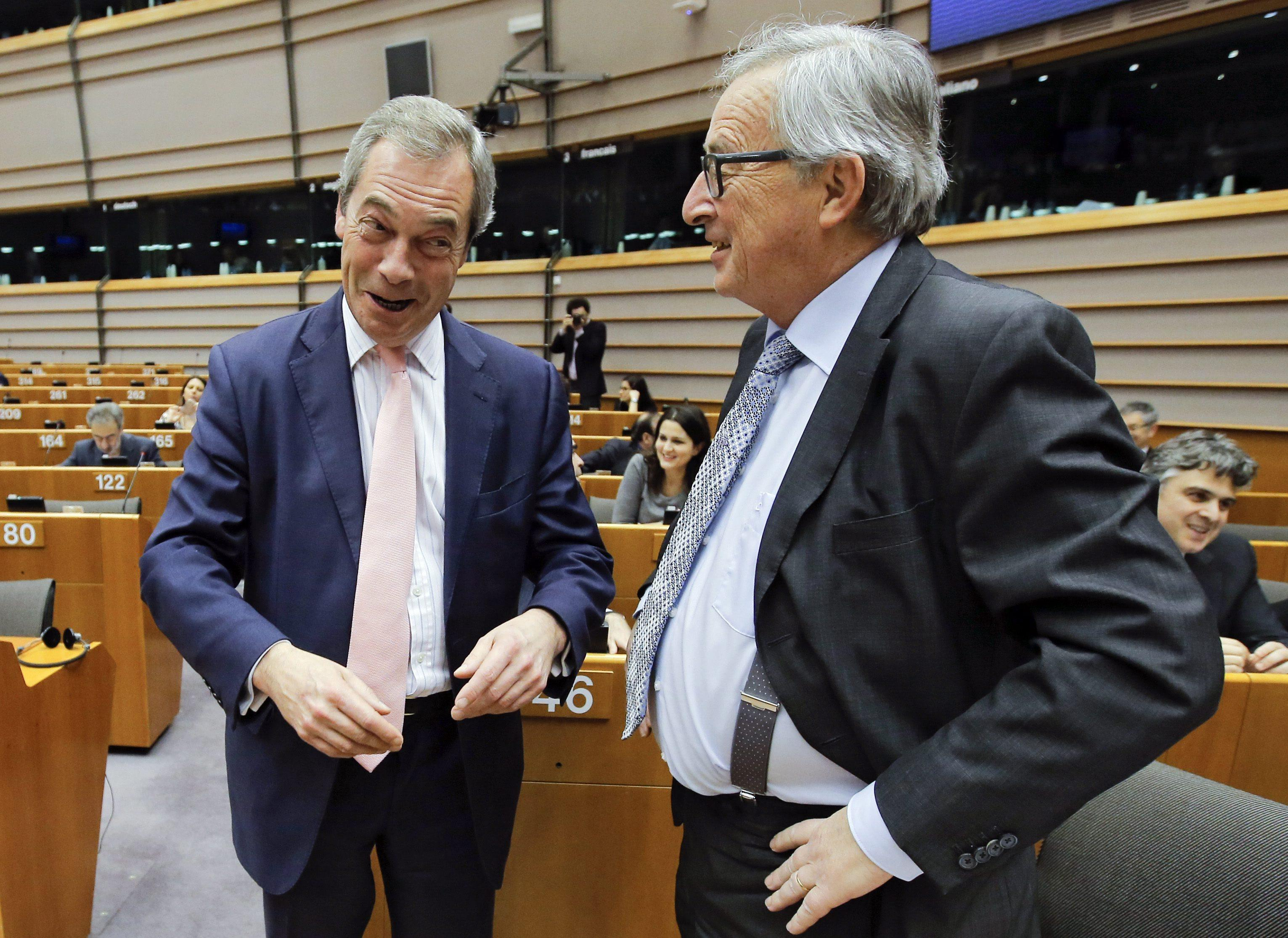 epa05178542 Nigel Farage (L), leader of the United Kingdom Independence Party (UKIP) and Member of the European Parliament, and European Commission President Jean-Claude Juncker (R) chat at the start of a European Parliament plenary session held in Brussels, Belgium, 24 February 2016. According to the Parliament's agenda, members of parliament are to discuss the results of of the European Council meeting held on 18 and 19 February which was topped by negotiations over a deal with Britain. EPA/OLIVIER HOSLET