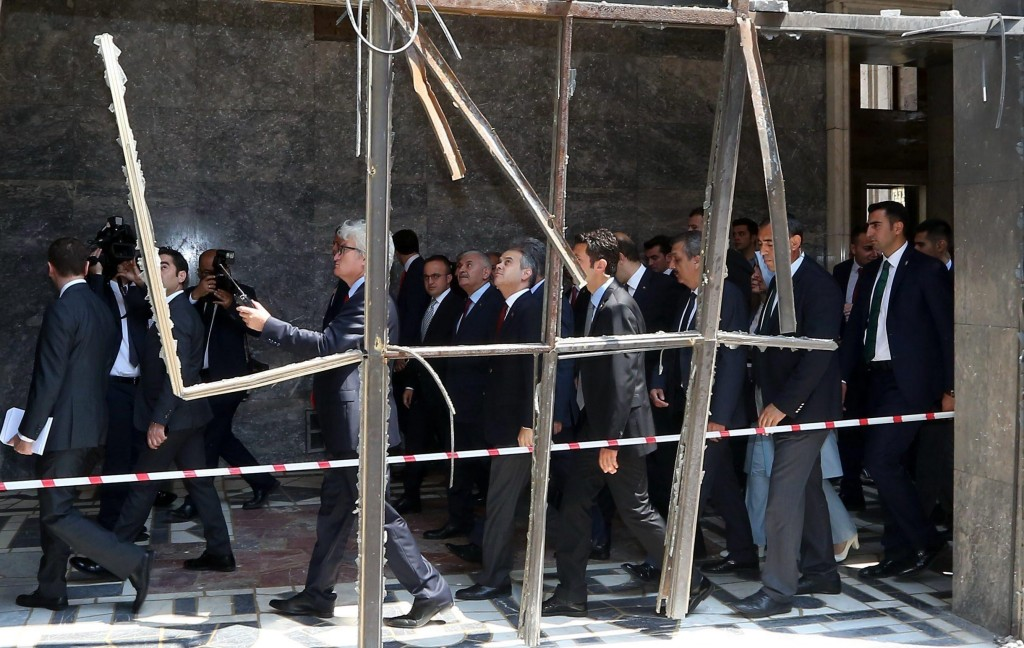 epa05431813 Turkish Prime Minister Binali Yildirim (C) visits a destroyed part of the Turkish Parliament in Ankara, Turkey, 19 July 2016. Turkish Prime Minister Yildirim reportedly said that the Turkish military was involved in an attempted coup d'etat. Turkish President Recep Tayyip Erdogan has denounced the coup attempt as an 'act of treason' and insisted his government remains in charge. Some 104 coup plotters were killed, 90 people - 41 of them police and 47 are civilians - 'fell martrys', after an attempt to bring down the Turkish government, the acting army chief General Umit Dundar said in a televised appearance.who were killed in a coup attempt on 16 July, during the funeral, in Istanbul, Turkey, 17 July 2016. Turkish Prime Minister Yildirim reportedly said that the Turkish military was involved in an attempted coup d'etat. Turkish President Recep Tayyip Erdogan has denounced the coup attempt as an 'act of treason' and insisted his government remains in charge. Some 104 coup plotters were killed, 90 people - 41 of them police and 47 are civilians - 'fell martrys', after an attempt to bring down the Turkish government, the acting army chief General Umit Dundar said in a televised appearance. EPA/STR