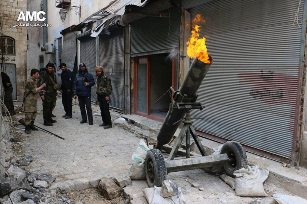 FILE - In this Sunday Feb. 15, 2015 file photo and provided on by the Syrian anti-government activist group Aleppo Media Center (AMC), which has been authenticated based on its contents and other AP reporting, shows Syrian rebels firing locally made shells against the Syrian government forces, in Aleppo, Syria. Islamic State militants entered a Syrian opposition stronghold in the country's north on Saturday, clashing with rebels on the edges of the town as the extremist group built on its most significant advance near the Turkish border in two years, Syrian opposition groups and IS media said. (ANSA/AP Photo/Aleppo Media Center, AMC, File)