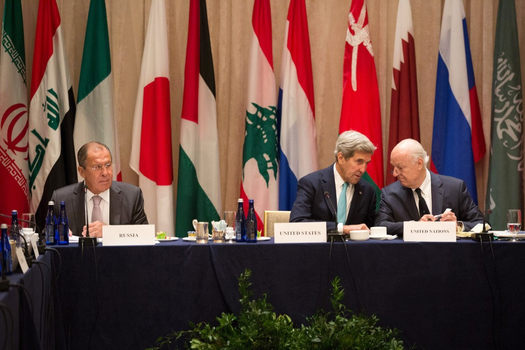 U.S. Secretary of State John Kerry, center, sits with United Nations envoy to Syria, Staffan de Mistura, right, and Russian Foreign Minister Sergey Lavrov during the International Syria Support Group meeting Tuesday, Sept. 20, 2016, in New York . (AP Photo/Kevin Hagen)