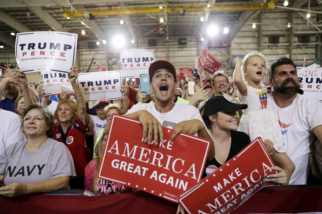 People cheer as Republican presidential candidate Donald Trump speaks at a rally Tuesday, Sept. 27, 2016, in Melbourne, Fla. (AP Photo/John Locher)